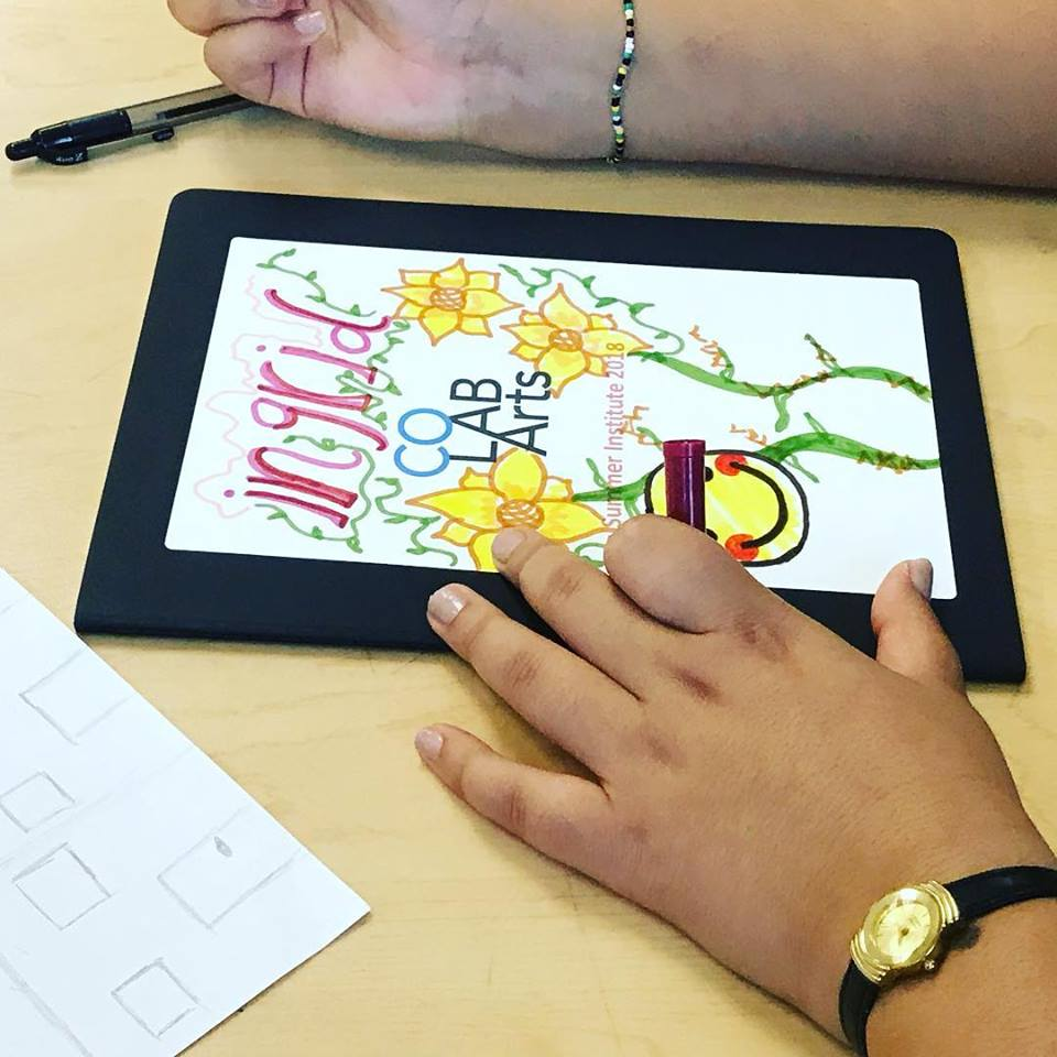 Person drawing on a tablet.