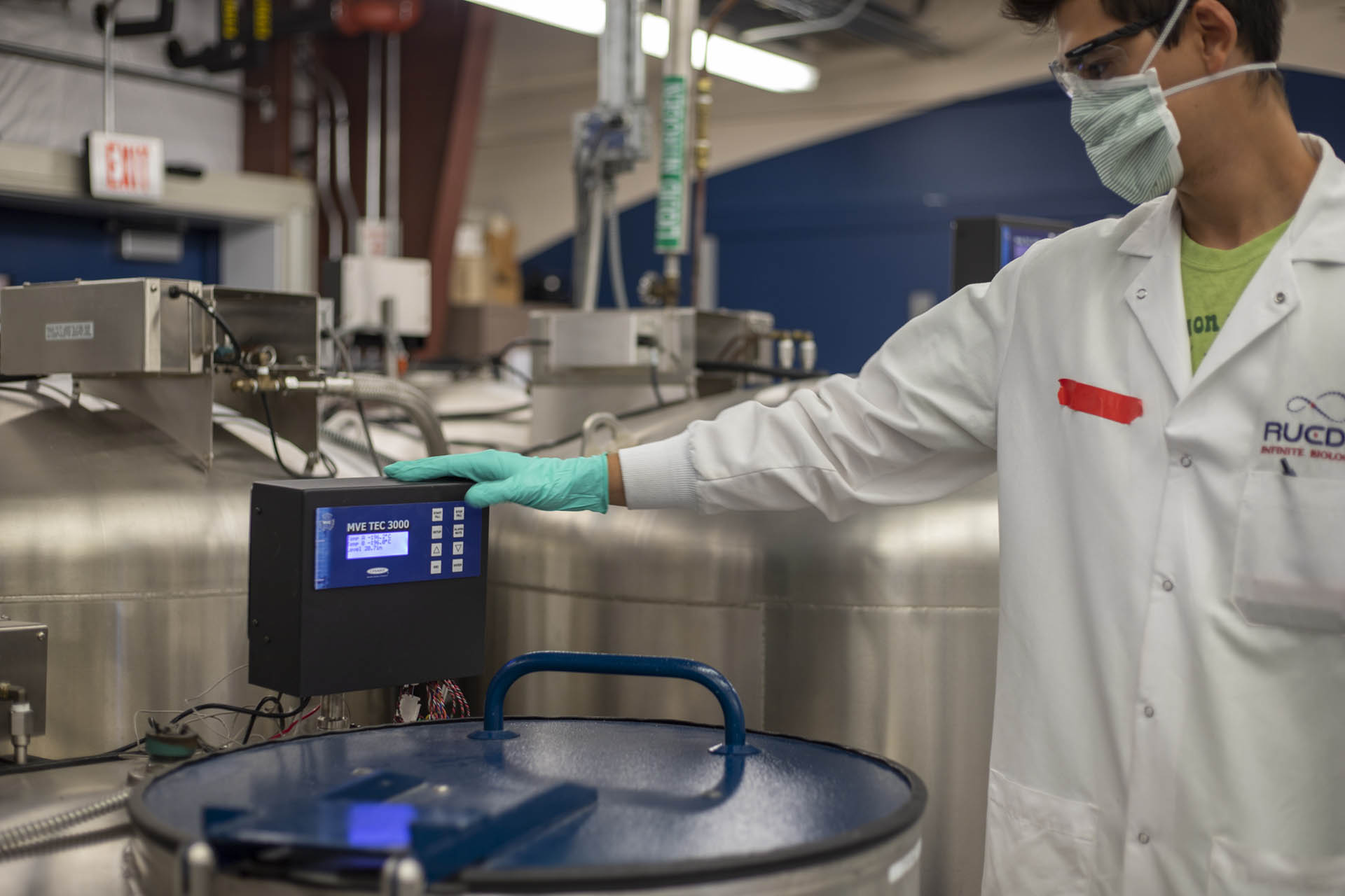 A laboratory researcher works with scientific equipment.